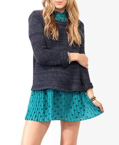 Loving the sweater-over-dress look. Just add knee high boots :)