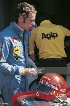 Austrian car racing driver Niki Lauda standing beside his Ferrari at the Italian Grand Prix. Monza, 8th September 1974