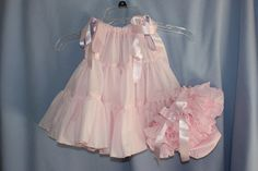 could be made from a vintage petticoat. Make armholes, insert ribbons, and you have a toddler size pillowcase dress.