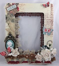 DIY Altered wood frame. More Cameos and flowers, less butterflies...
