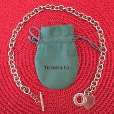 """Tiffany & Co. Necklace Beautiful, authentic Tiffany & Co. 925 Necklace!  16"""" from toggle to ring.  Good used condition- some small scratches on charm, and a small mark on the bag.  No trades.  Bundle to save! Tiffany & Co. Jewelry Necklaces"""