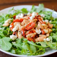 White Bean Salad with Oven-Roasted Tomatoes, Goat Cheese, and Pine Nuts.