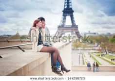 Lovers in Paris with the Eiffel Tower in the Background - stock photo