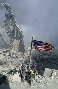 American Flag flying over the runes of the World Trade Center