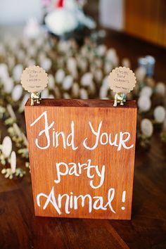 Escort cards don't have to be limited with paper. Write them on something else entirely or pair with them with a fun accessory. These gold spray painted animal figurines are fun and playful.