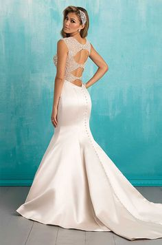 This fit-and-flare gown holds its shape beautifully, featuring gorgeous crystal beading at the back. See photos of Allure Bridal's Spring 2016 wedding dress collection.