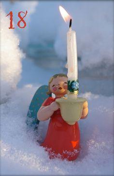 18. Türchen Wendt und Kühn Engel mit Lichtnapf und Kerze im Schnee