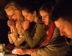 Prayers: Women mourn at a candlelit and floral memorial to the victims at the Place de Rep...