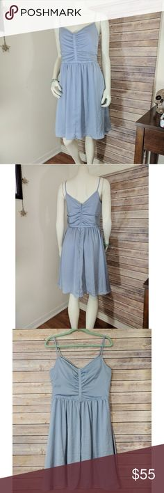 """Banana Republic Light Blue Flowy Dress Features spaghetti straps, ruched details on front and back, hidden back zipper, full gathered skirt with hidden pockets, and v shaped front and back.   Only imperfection is a small tan stain on front. 5th pic. May be removable. Otherwise looks like new.  Reminds me of Cinderella!  Measurements laid flat:  Armpit to Armpit: 17.5"""" Waist: 15.5"""" Length top shoulder to bottom hem: 38.5""""  Seems to fit like an 8. Banana Republic Dresses Midi"""
