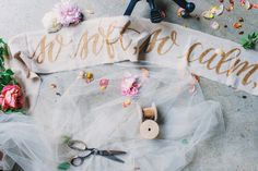 Gold calligraphy on fabric by Ashley Buzzy Lettering + Press, image by Rustic White Photography. #wedding