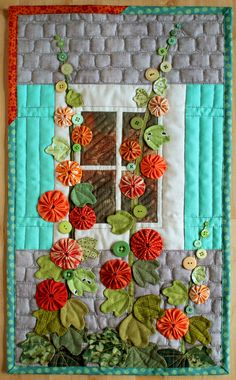 I made this Hollyhock quilt for a mini quilt swap. My partner liked yo-yos and the colour orange so hollyhocks immediately popped to mind! .......... blog 30th Sept 2016