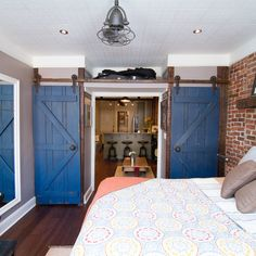 Closet barn doors in this bedroom double as privacy doors when pulled shut in this New York City apartment. | thisoldhouse.com/yourTOH