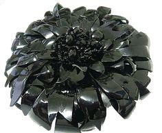 Glossy black leather brooch