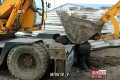 A resident in northeast China was brutally killed on May 15 when he tried to stop his home from being razed by the government-employed demolition team. The operator of the heavy equipment also died a horrific death.