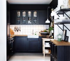 Modern Small Kitchen Remodel Ideas With Black Painted Maple Wood Kitchen Island Using Wooden Countertop And White Tiled Backsplash As Well A...