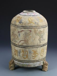 China, Han Dynasty, painted jar with tripod animal feet, decorated with colorful paintings of calligraphy characters and figures engaged in various activities. Height 14 1/2 in.
