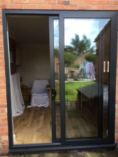 AluK GB Ltd Aluminium sliding patio door in anthracite grey with a chrome handle. Installed in West Bridgford, Nottingham. Contact us today on 01158 visit or pop into our West Bridgford showroom for a free quotation. Kitchen Patio Doors, Kitchen Sliding Doors, Aluminium Sliding Doors, Sliding Glass Door, House Window Design, Door Design, House Design, Garden Doors, Windows And Doors