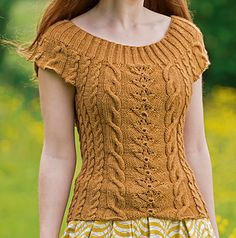 Cables are always so enjoyable to knit, and with this pretty top you can wear them all summer long! It features an unusual climbing rose pattern surrounded by classic braids.