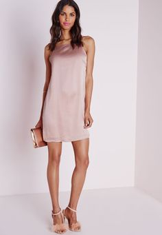Play up to your feminine side in this pretty powder pink mini dress. With luscious silk feel fabric and slinky box straps to reverse this cami is fanciful. Wear with strappy heels and feather clutch for a standout look.