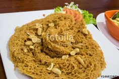 "Download the royalty-free photo ""The delicious Thai crispy catfish salad on white plate."" created by phasuthorn at the lowest price on Fotolia.com. Browse our cheap image bank online to find the perfect stock photo for your marketing projects!"