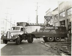 [Model T 16 - L 8 in front of Stuart Oxygen Co. loading gas ... by New York Public Library, via Flickr