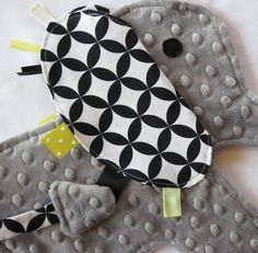 Taggy toy boy version. Must make one for Baby J. Love yellow and gray!