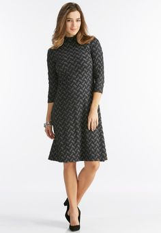 Start the season off right in this chic knit dress, featuring a textured checkered design, trendy mock neckline and flattering fit and flare silhouette.       3/4 sleeves     Back zipper closure     50% rayon, 48% polyester, 2% spandex     Machine wash     Imported