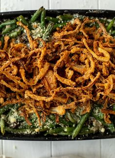 This green bean casserole from scratch is super delicious and topped with french fried onions! It's comforting and wildly flavorful.