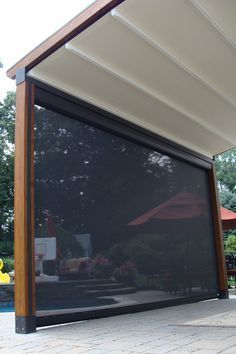 The Gennius Pergola Awning with cover projected, and solar shade dropped