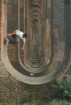Skateboarder on a brick arch