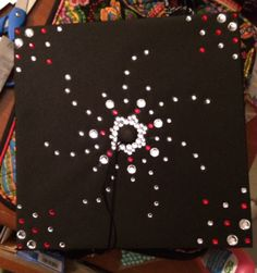 DIY graduation cap decoration.  Single rhinestones with university's school colors.