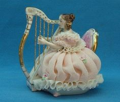 Pretty lady in Crinoline playing the Harp