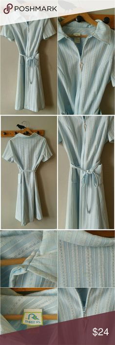 Vintage pale blue dress fit flare size 12 14 large This pretty day dress is a pale sky blue with vertical woven stripes. It has a pointy collar and pockets at the hips. Self fabric tie belt. The tags reads Three R's size 18.5 and would fit best modern size 12 to 14. Medium weight polyester fabric. In good condition with a few small brownish stains, may come out with focused spot cleaning. True vintage made around 1970s. Short sleeve fit and flare A line shape. From a smoke free home :) Bust…