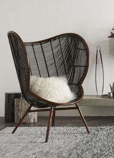 The Roost Olaf Chair with its sinuous rounded lines inspired by Danish Modern design invites lingering in the generous seat and enveloping arms. Stained rattan in mahogany and ebony tones is artfully hand-woven to create this graceful chair. Rattan Furniture, Home Furniture, Furniture Design, Rattan Chairs, Black Furniture, Interior Design Minimalist, Modern Design, Decoration Inspiration, Take A Seat