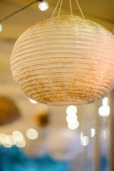 glitter dusted lanterns, photo by Sean Money + Elizabeth Fay http://ruffledblog.com/glittered-charleston-wedding #paperlantern #lighting #gold