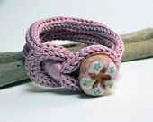 Fuchsia and turquoise knitted wool yarn bracelet Noemi, crocheted button, tied up, yarn jewelry. €18,00, via Etsy.