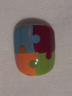 Puzzle Piece Nails - http://www.youtube.com/watch?v=giJgZKDKHwM