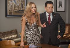 """Nationals judges Lindsay Lohan (guest-starring as herself, L) and Martin (guest star Rex Lee, R) have a discussion in the second hour of a special two-hour """"Props/Nationals"""" episode of GLEE"""