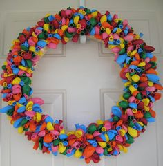Six Sisters' Stuff: The Birthday Balloon Wreath ~ looking for fun ways to make birthdays more special?  Here's it is and it's so easy and pretty inexpensive. And look how cute it is!
