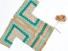 """Not your granny's granny stitch! In Part 2 of this free crochet sweater pattern, we'll learn how to lengthen the bottom of your """"Campfire Cardigan"""" and add sleeves. Made with Lion Brand New Basic 175 yarn."""