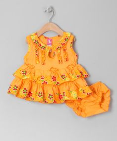 Rows of ruffles, bright colors and comfy cotton combine to create the picture of youthful sweetness. This cheerful dress is a great go-to for any day, while the matching diaper cover adds an extra-coordinated touch. Includes dress and diaper cover100% cottonMachine wash; tumble dryImpo...