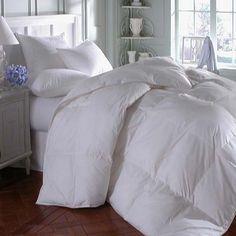 Oversized comforter = cozy bed