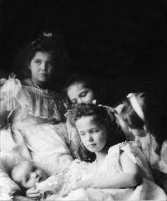 otma-romanov-forever:  Baby Tsarevich Alexei Nikolaevich with her sisters Maria, Anastasia, Olga and Tatiana Nikolaevna…