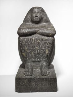 Block Statue of Padimahes, ca. 680-650 B.C.E. Granodiorite, 18 1/4 x 8 11/16 x 12 5/8 in. (46.3 x 22 x 32.1 cm). Place collected Taremou (Lenontopolis), Egypt.