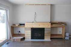 Want to build DIY fireplace built ins? See the play-by-play of how our craftsman style built ins were created using MDF, white paint, stone & marble tile. Fireplace Built Ins, Dorm Room Diy, Simple Bed, Home, Build A Fireplace, Fireplace, Diy Fireplace, Bookshelves Diy, Shiplap Fireplace