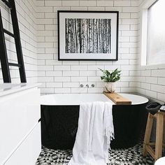 You can achieve this stunning harlequin floor tile look with the triangle mosaic tiles from @dilorenzo_tiles - completely unique and the perfect combination with a freestanding black tub! Pic via @socialhomeideas | Kaz #blackandwhite #bathroom #renovation #interiors #interiordesign #decor #tiles #homedecor #thestylephiles