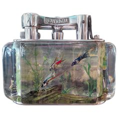 Alfred Dunhill 'Aquarium' Table Lighter | See more antique and modern Tobacco Accessories at https://www.1stdibs.com/furniture/more-furniture-collectibles/tobacco-accessories