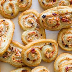 A really cute savory appetizer recipe for Sun Dried Tomato Olive & Goat Cheese Palmiers. Perfectly sized for snacking.