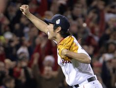 CrowdCam Hot Shot: Boston Red Sox relief pitcher Koji Uehara celebrates after game six of the MLB baseball World Series against the St. Louis Cardinals at Fenway Park. The Red Sox won 6-1 to win the series four games to two. Photo by Robert Deutsch