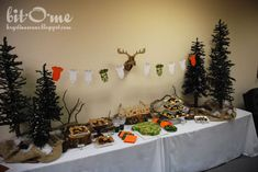 hunting party ideas   The centerpieces were made from logs cut in various heights. I placed ...